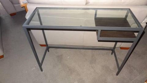 Narrow Desk with glass top,metal frame,shelf below.100Lx 36Dx74H