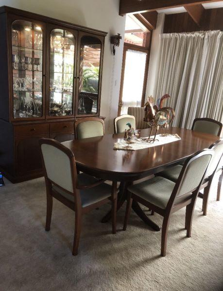Large wooden Noblett dining table with included chairs