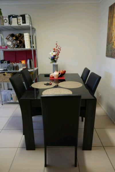 Matching lounge and dining furniture set wood and glass