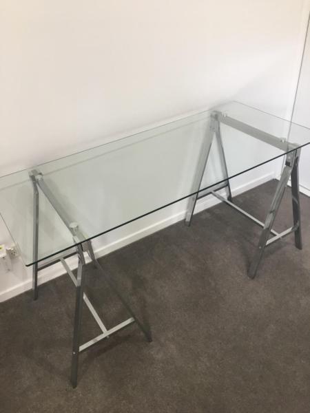 Glass top trestle leg table