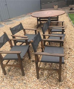Sou Wester Hardwood outdoor 1800m round table with 5x chairs