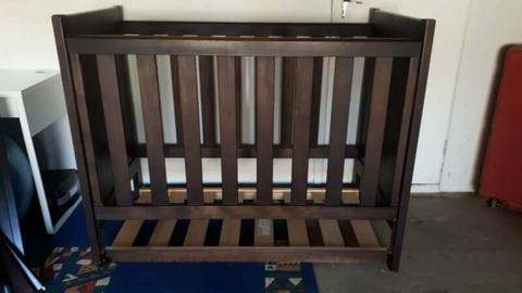 Dark brown babies cot and change table
